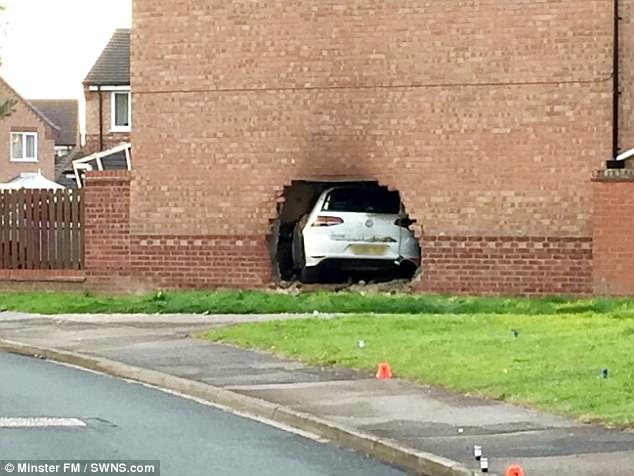 Four injured as auto smashes into lounge of house in York