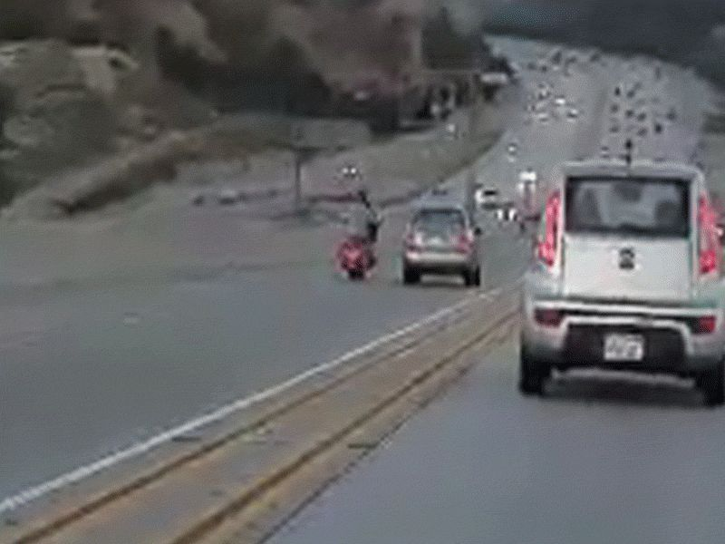 Motorcyclist kicks auto in road rage incident, starts accident